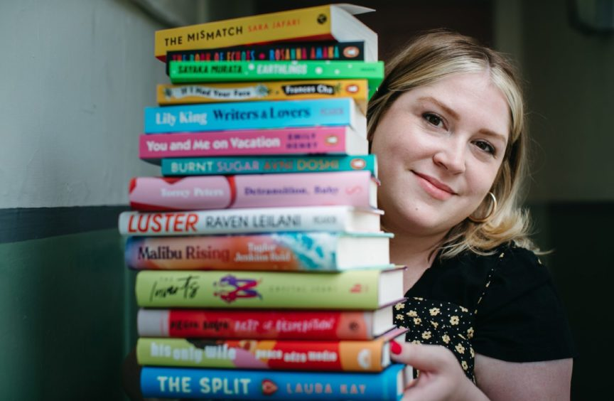 Rachel Wood with a pile of books