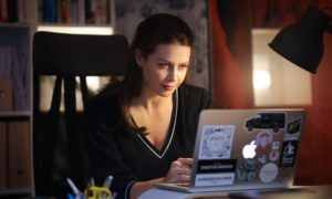 Scarlett Hollerin works on her laptop at home where she juggles the demands of parenthood and running a PR firm