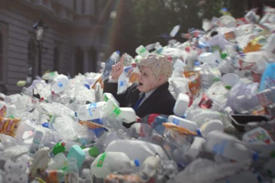 A model of Boris Johnson is swept out of Downing Street in a deluge of plastic waste in a campaign film from Greenpeace