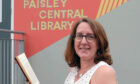 Paisley Central Library Team Supervisor, Linda Flynn with the Mrs Balbir's Singh's Indian Cookery book that was returned more than 50 years overdue