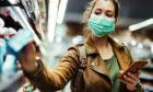A shopper in a face mask