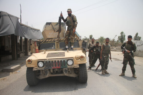 Afghan security force members take part in a military operation against Taliban militants