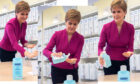 Nicola Sturgeon washes hands on visit to NHS24 contact centre in March