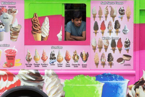 An ice cream man in his van in Washington DC last June