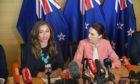 Greens' Marama Davidson and Labour's Jacinda Ardern seal a New Zealand coalition in November 2020