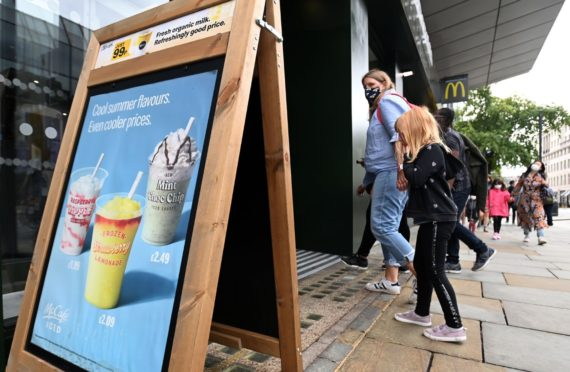 Diners enter a McDonald's restaurant in London, but the company warns of shortages