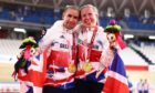 Lora Fachie and husband Neil Fachie pose with their gold medals
