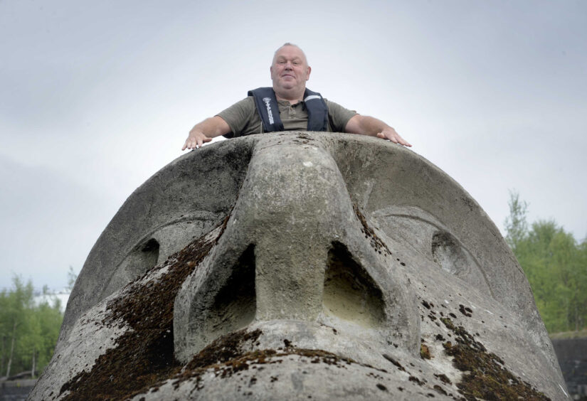 Andy Groom, brother of artist Richard Groom, on the 27-tonne concrete and steel Floating Head
