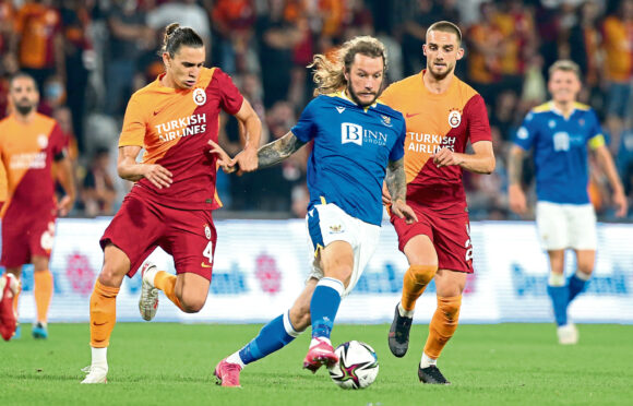 St Johnstone's Stevie May goes on the attack against Galatasaray in Istanbul.
