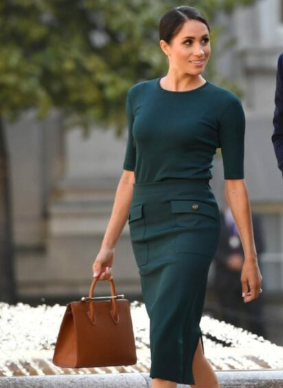 Meghan Markle was seen with her bag designed by Scottish bag maker Strathberry during a visit to Dublin in 2018