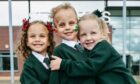 Triplets Alyssia, Caleb and Poppy Stirrat in their new uniforms and about to start school, at St Eunan's Primary in Clydebank
