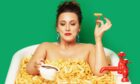 Grace Dent poses in a bath of chips