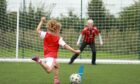 Maya Sher takes a shot as Judy Murray keeps goal at Lewes FC as she was filming Driving Force last week