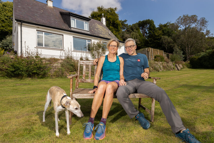 Fiona Russell and her husband Gordon in their garden