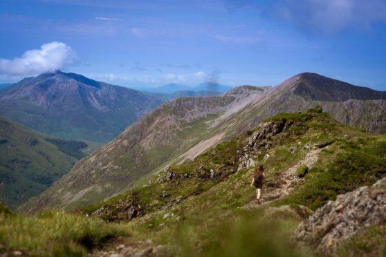 Hiking towards Aonach Eagach ridge in Glen Coe
