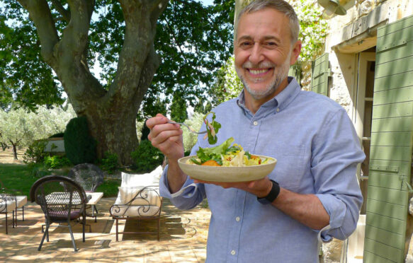 Michel Roux in the villa garden eating his salade compose dish on his new series