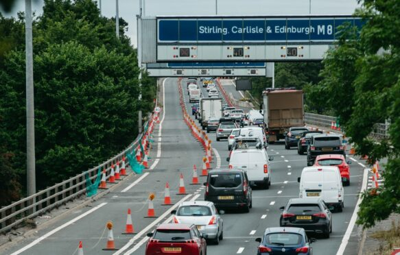 The M8 eastbound in Glasgow is congested on Friday with lanes closed due to work on supporting pillars