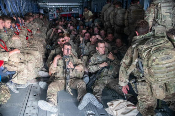 UK military personnel onboard an aircraft departing Kabul