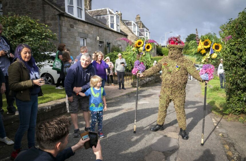 The Burryman is led through South Queensferry