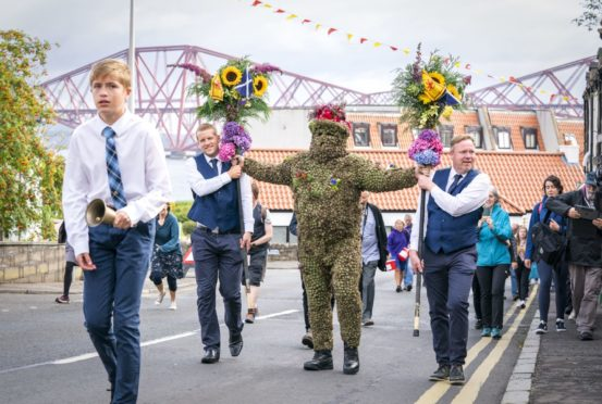Burryman Andrew Taylor parades through the town of South Queensferry