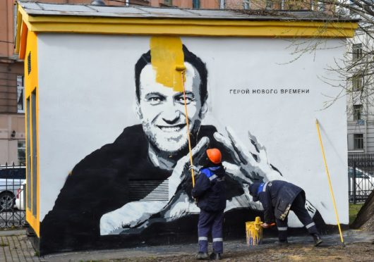 A mural in St Petersburg declaring Alexei Navalny a 'hero of a new time' is painted over by Russian authorities