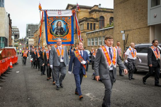 Members of the County Grand Orange Lodge take part in the annual Orange walk parade which passed though the city centre on September 18, 2021 in Glasgow.