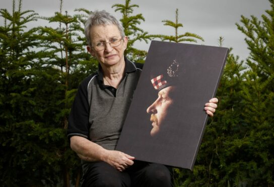 Dagmar with a picture of Brian, a former Gordon Highlander, at her home in Portsoy