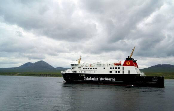 MV Finlaggan passes by the Isle of Jura