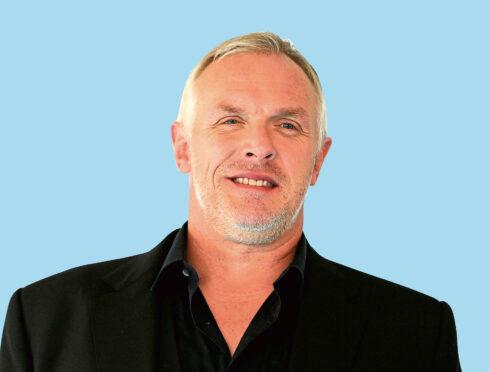 Greg Davies.