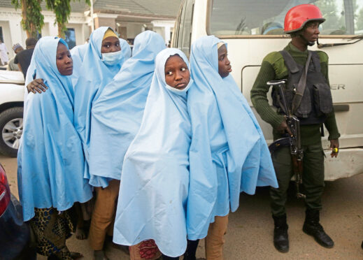 Some of the Government Girls Secondary School students who were abducted by gunmen the previous week in Jangebe, Nigeria, wait for a medical checkup after a meeting with Zamfara state Gov. Bello Matawalle, in Gusau, northern Nigeria.