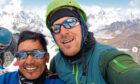 Lakba Sherpa on the summit of Ama Dablam in Nepal.