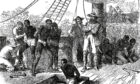Slavers forcing kidnapped African people below deck to cross the Atlantic.