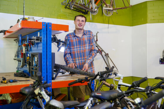 Wilf in the bike shop. (Ross Johnston/Newsline)