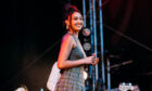 Joy Crookes on stage at TRNSMT