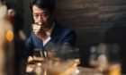 Koji Shimaoka, founder of the new Komoro distillery, samples a whisky at Bar Queen's-Q in Tokyo