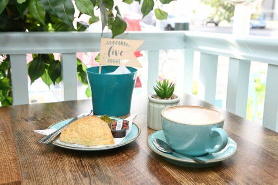 Triangle scone and cappuccino at Orka