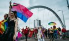 Mardi Gla parade heading over Glasgow's Clyde Arc
