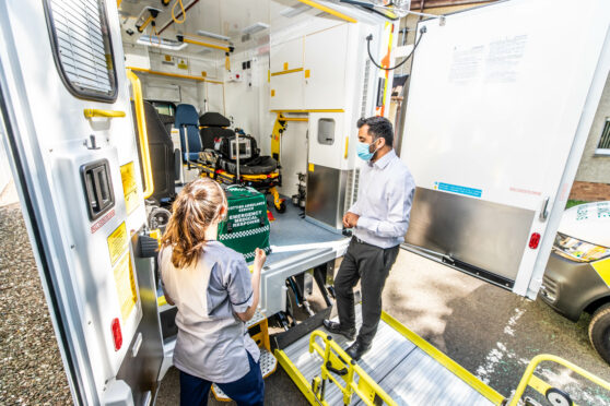 Humza Yousaf is shown around an ambulance by student paramedic Lizzie Hilton in Dundee in July
