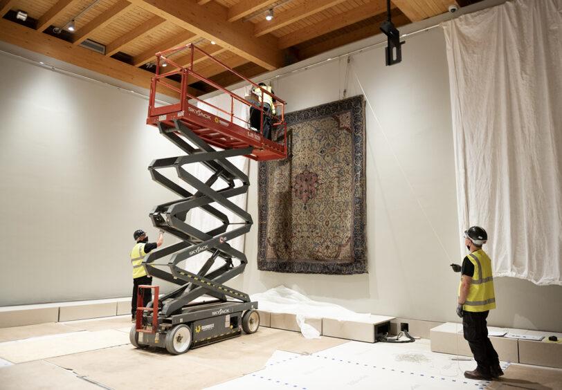 The Arabesque Carpet being installed