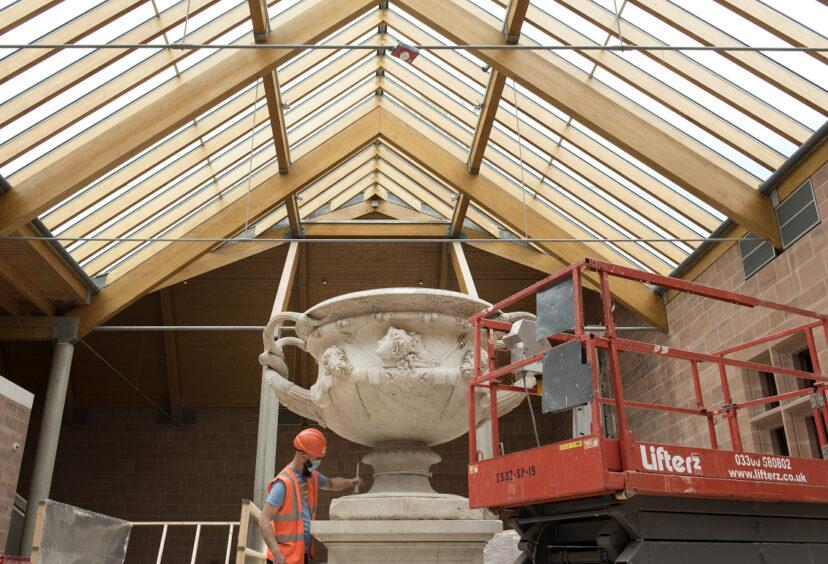 Warwick Vase being cleaned