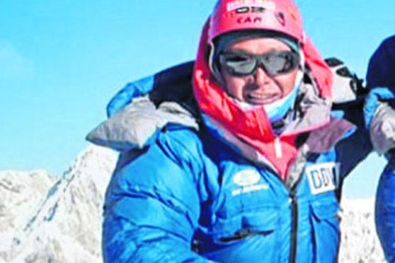Lakba Sherpa on the summit of Ama Dablam in Nepal