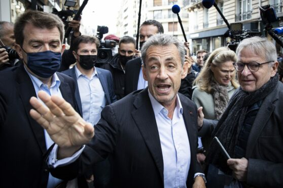 Former French president Nicolas Sarkozy greets his supporters, ahead of a signing session for his new book Promenades.