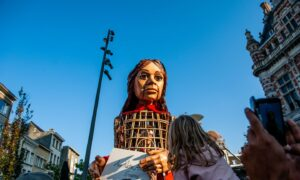 Little Amal, a giant puppet inspired by a Syrian child refugee, arrives in Antwerp last week as part of a journey from the Syrian border across Turkey, Greece, Italy, France, Switzerland, Germany and Belgium symbolising the search of her mother.