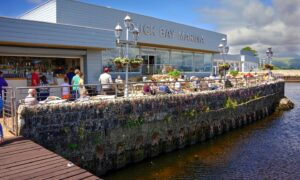Diners take in the magnificent loch views