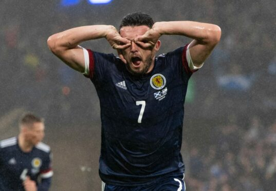 John McGinn opts for an unusual celebration after scoring Scotland's opener against Israel at Hampden last night.
