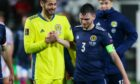 Craig  Gordon is  congratulated by Andy Robertson on his  performance in Torshavn last Tuesday night.