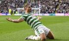Celtic's Giorgios Giakoumakis celebrates his opener against St Johnstone