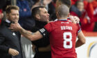 Stephen Glass and Scott Brown celebrate with Christian Ramirez after he put Aberdeen ahead yesterday