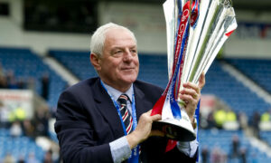 Rangers boss Walter Smith celebrates with the league trophy in 2011