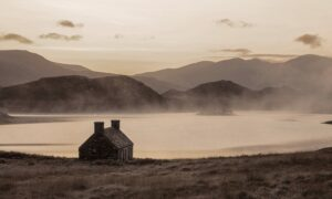 Fog hovers over Loch Stack, near a lone bothy, in Sutherland in an amazing image captured by photographer Richard Gaston during gruelling Cape Wrath trek